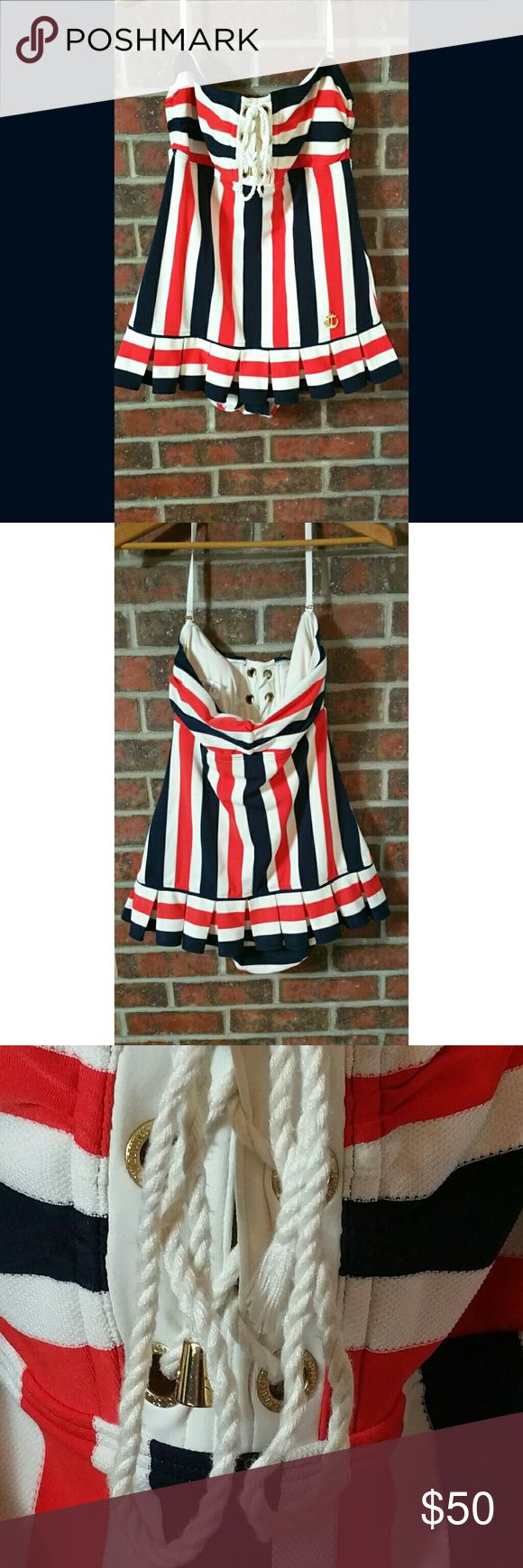 Juicy Couture Siren red white blue swimdress large Juicy Couture swimsuit size large. Red white and blue stripes. Halter style.  Nautical style perfect for the 4th of July. In gently used condition. It is missing a rivet on the front tie. Juicy Couture Swim One Pieces