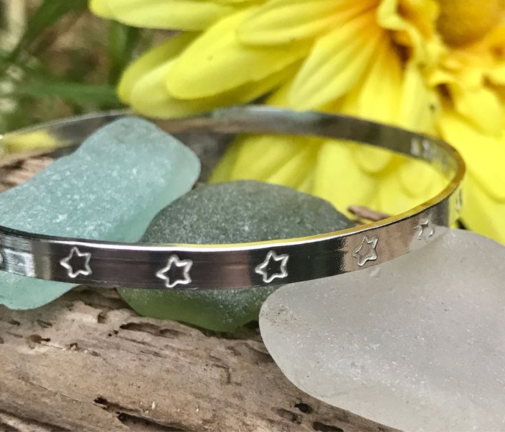 A personal favourite from my Etsy shop https://www.etsy.com/uk/listing/541428205/silver-wide-personalised-bangle-hand