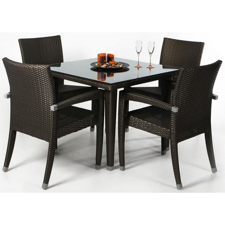 $1,485.00 All Things Cedar Rattan - 5pc Patio Table Set This 5 piece dining set comes with 4 chairs and 1 table with a chestnut (dark) brown finish. The table includes a 1/2'' glass plate table top. The chairs are decorated with aluminum leg ferrules. The wicker contains UV inhibitors that repel the damaging effects of the sun & harsh weather equaling a maintenance-free wicker.The frame is made out of heavy-gauge powder coated aluminum which is guaranteed never to rust.