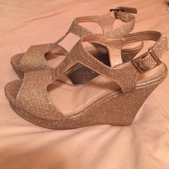 Gold sparkly prom shoes Rampage brand Rampage brand, very comfortable gold prom/homecoming heels. Size 7 1/2. ❤️ wedge form! Adjustable buckle Rampage Shoes Heels
