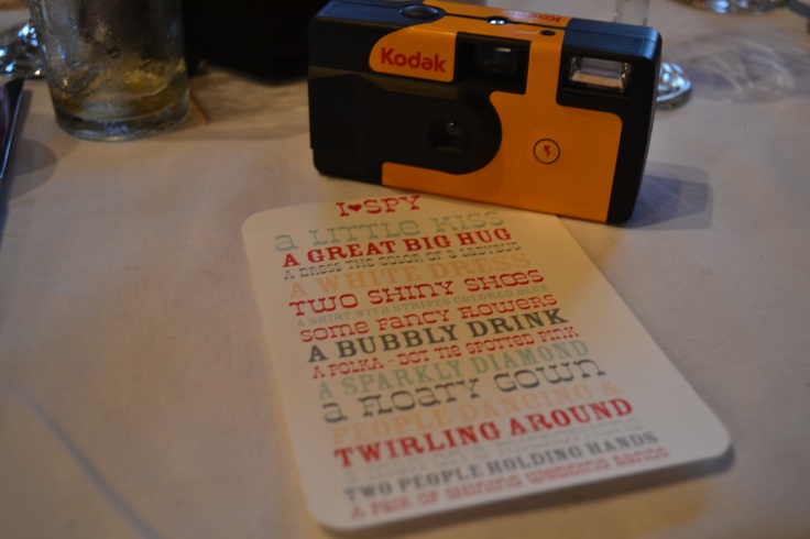 """""""I SPY"""", we placed a disposable camera at each table with the card for guests to take photos from the list. Then to have each camera roll printed so that we have a different view of our wedding through their eyes"""