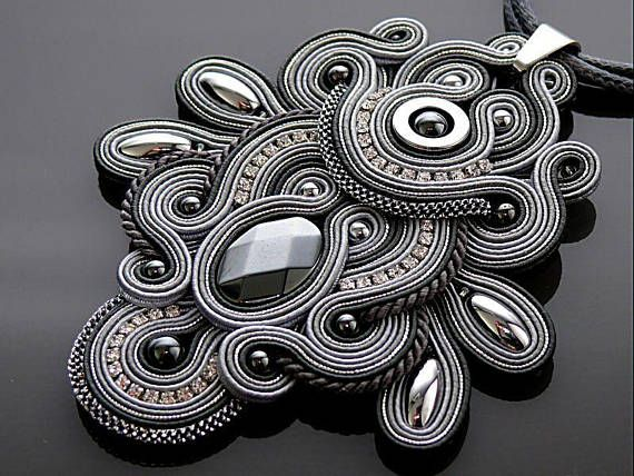 Beautiful, impressive soutache pendant, made of soutache strings with Hematite and glass beads. Full length: 4.2 inches. Length of string: 24.8 inches Colour: gray, silver and graphite.
