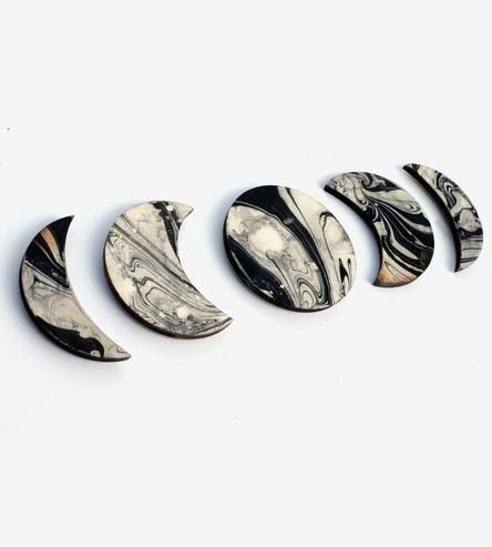 Show off photos, doodles and important pieces of information on the fridge with this set of celestial magnets. The lunar phases are laser cut from wood and marbled with an ancient water painting technique to create the swirls and organic shapes. Each marbled moon shape is fitted with especially strong magnets, to firmly stick onto message boards and fridge doors.