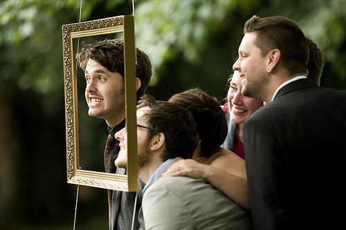 Hanging a frame outside so people can take funny/sweet/silly pics at the wedding!  -- Lucy & Dan's vintage vegan Buddhist wedding   Offbeat Bride