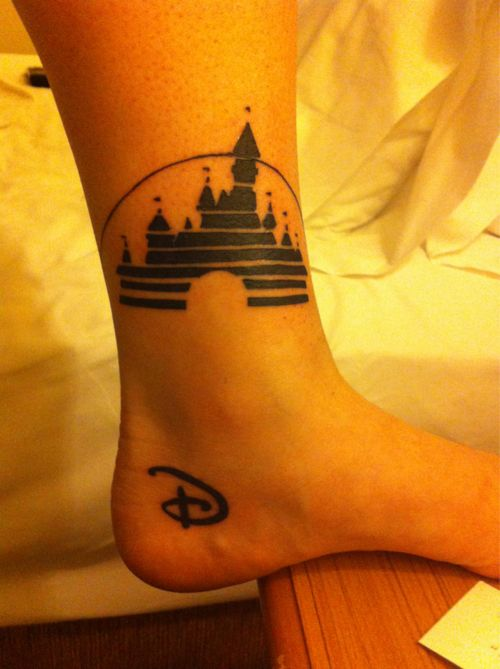 "Disney tattoo! I don't like the idea of the castle right there but the ""D"" is so cute !"
