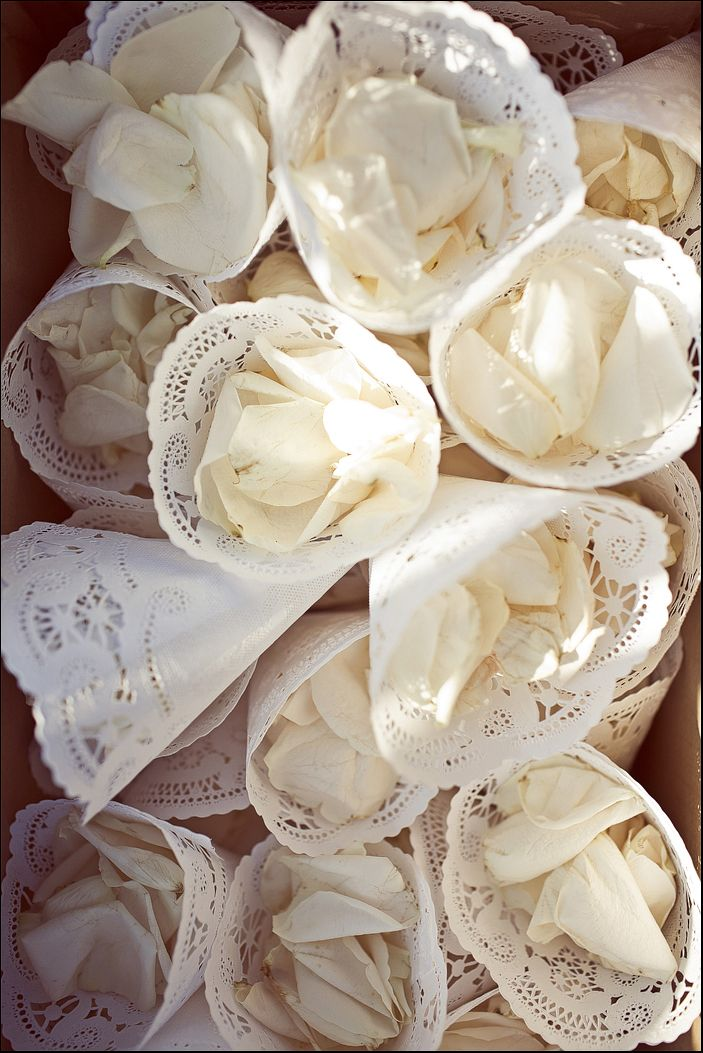 doilies make great holders for flower petals (or whatever else you want be thrown at the bride & groom)
