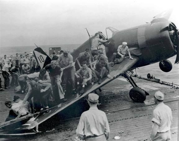 Ship crew put their weight on damaged Hellcat to keep it from falling into sea; 1944