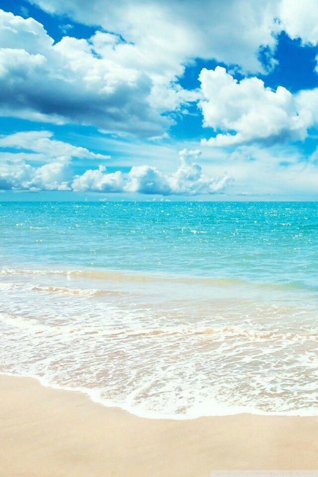 Clouds, sky, ocean, tide, and sandy beach.