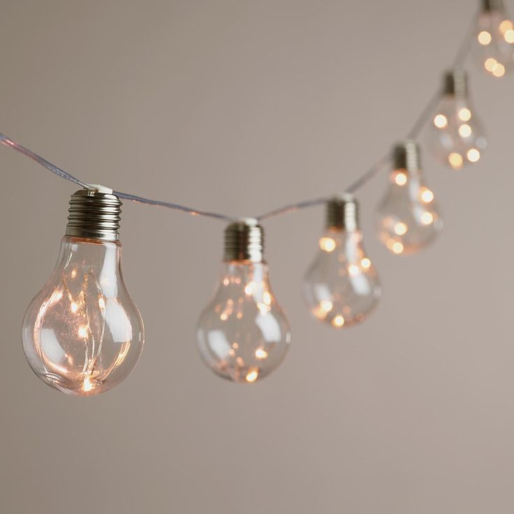 Our exclusive string lights feature 10 World Market favorite Edison bulbs, each filled with five micro-LED lights that glow like fireflies. Battery-operated for maximum versatility, these affordable vintage-style string lights turn on and off automaticall