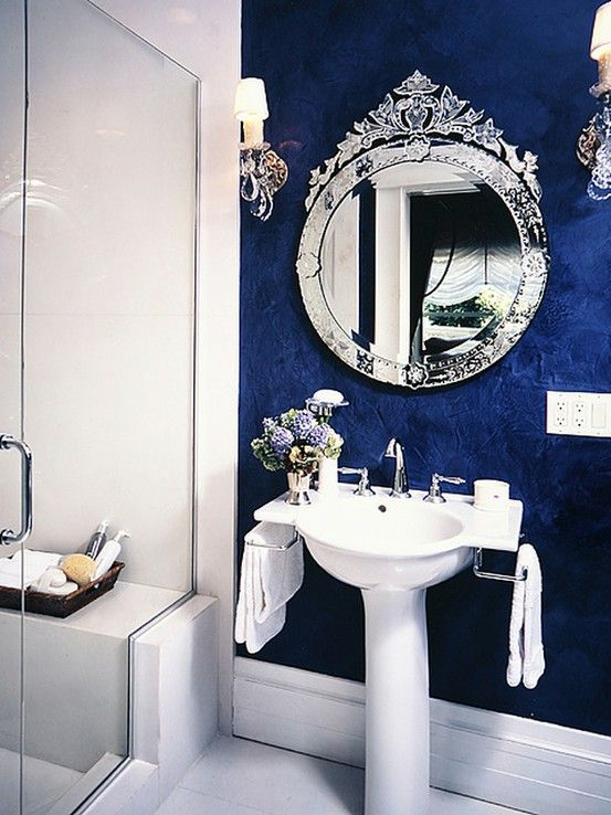 Everyone always does deep reds in rooms.  I love this contrast of saphire blue and white!