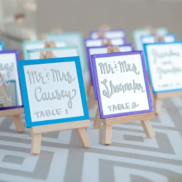 Using Chalk Ink Markers, mini-easels and mini-mirrors we are showing you how to make the most darling escort cards you've ever seen!