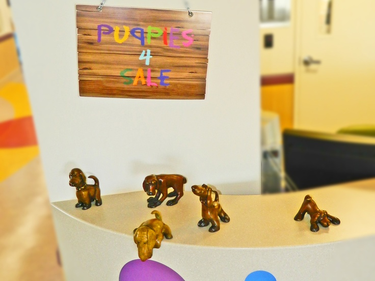 One bronze puppy by Marty Goldstein peers down at tiny visitors to Renown Children's Hospital.