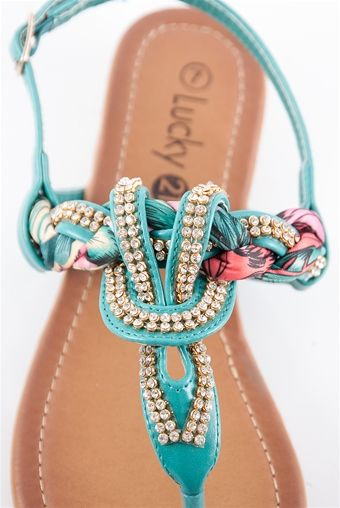 Jeweled and Woven Scarf Thong Sandal - Teal from Lucky 21  These sandals are covered in sparkling jewels and have a woven scarf intertwined. Dress up your feet in these super cute and comfortable sandals with adjustable buckle for the perfect fit.