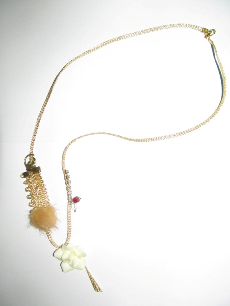 Handmade necklace (1 pc)  Made with beige fimo flower, synthetic metal look look cord, fabric details, glass beads, fur, crystals and brass metal.