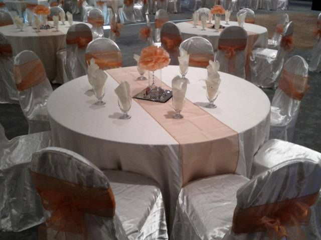 White Satin Chair Covers And White Polyester Tablecloth Accented By Pumpkin  Sashes And Table Runner! Beautiful Picture From An Amazing LinenTableclu2026