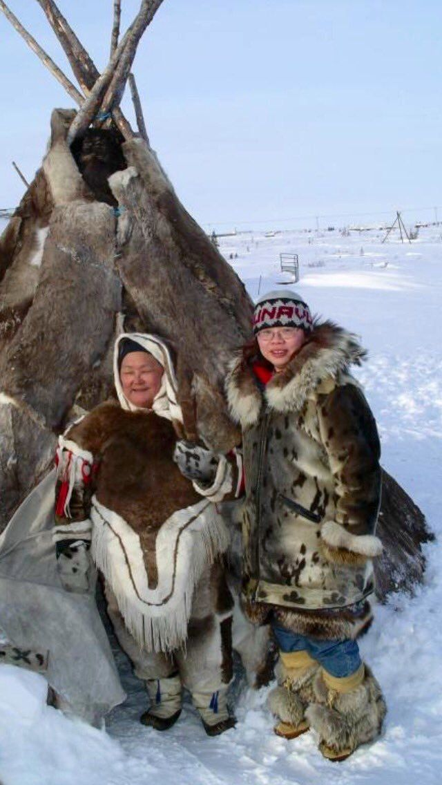 A mother with her daughter in front of the tipi, inuit tribe - Alaska