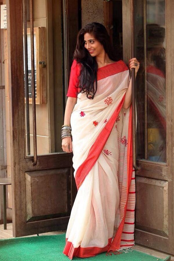 Elegance.....shada saree lal paad