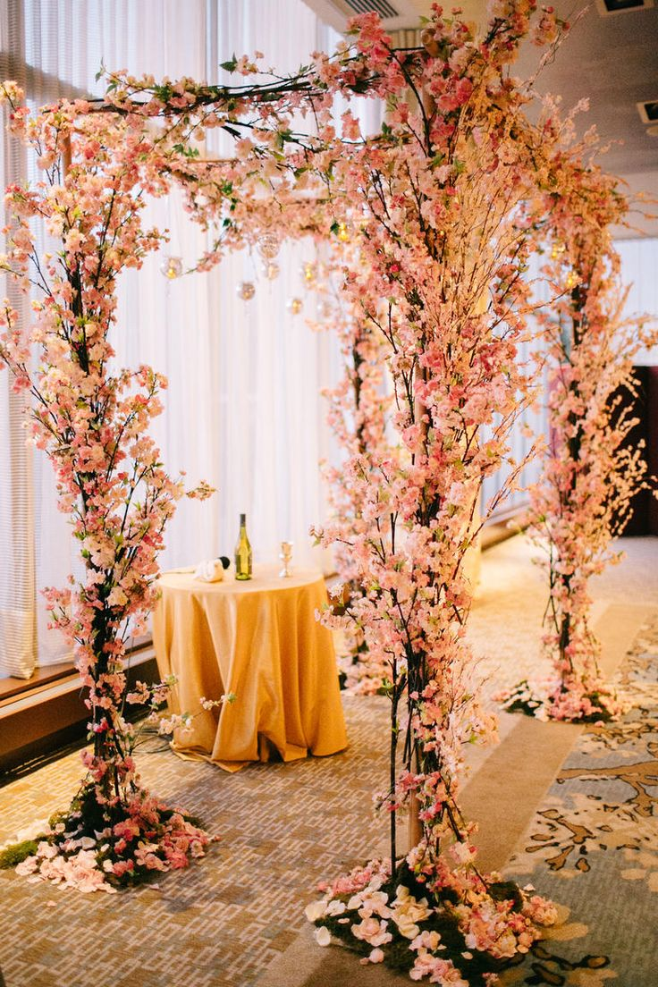 A Cherry Blossom Chuppah | 23 Wedding Chuppah Ideas We Love | https://www.theknot.com/content/creative-wedding-chuppah-ideas