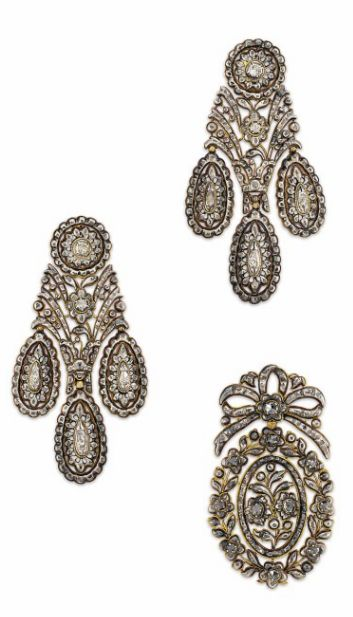 A PAIR OF LATE 18TH CENTURY DIAMOND GIRANDOLE EAR PENDANTS AND AN ANTIQUE PENDANT Of elongated form and rose-cut diamond-set throughout, each composed of a circular cluster top suspending an openwork floral and foliate panel and three pear shaped drop terminals; together with an associated oval shaped pendant, similarly-set with rose-cut diamonds in a floral wreath design, suspended from a bow surmount, closed-set in silver and gold