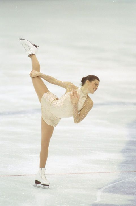 Best Olympic Ice Skating Costume: Nancy Kerrigan, 1994 In our minds, Nancy is the undisputed queen of the high-neck skating outfit. This champagne-color number was designed by former ice skater Vera Wang and was reportedly set with 11,500 rhinestones.