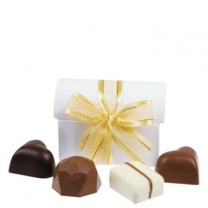 A shipper of 19 Treasure Chest White. Gorgeous white treasure chest shaped gift boxes, filled with four assorted chocolates.