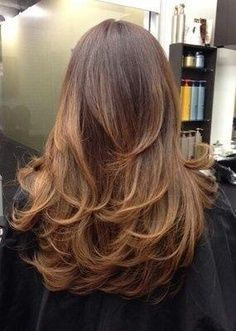 thick long hair with layers, not a v shape, its has a soft