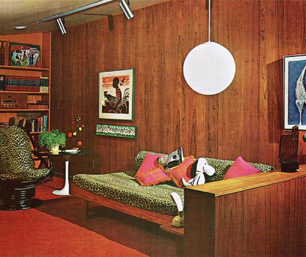 The husband just promised me that if we ever buy a house with an outdated basement with brown paneling, I can decorate it just like this! We looked at the perfect house like that a couple of weeks ago, but it sold immediately :(