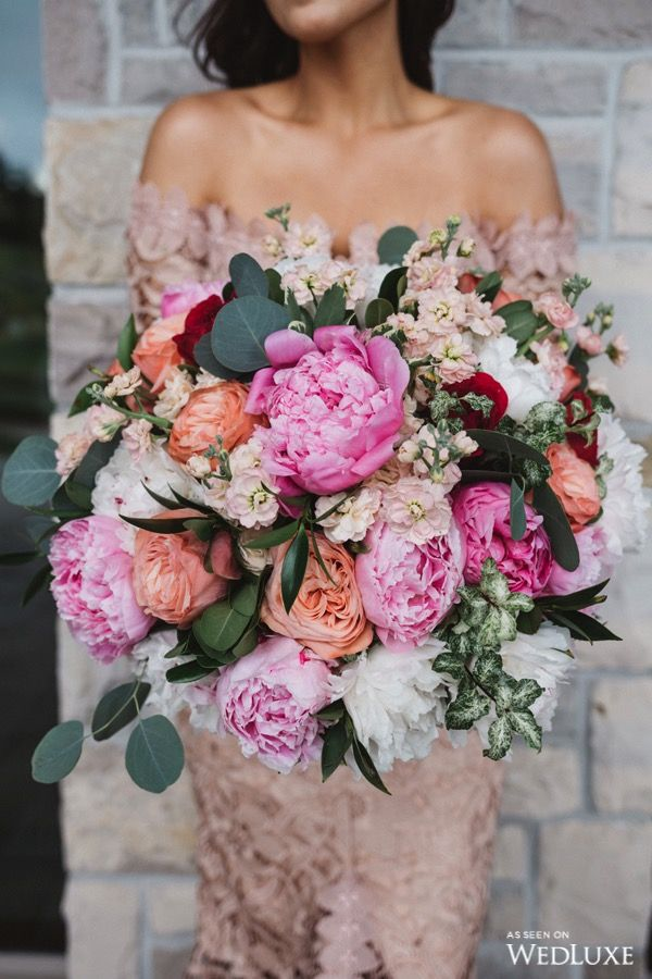 WOW! look at this gorgeous peony filled bouquet | Photography by: The Love Studio Follow @WedLuxe for more wedding inspiration! #wedding #weddingbouquet #peonies #peonoy