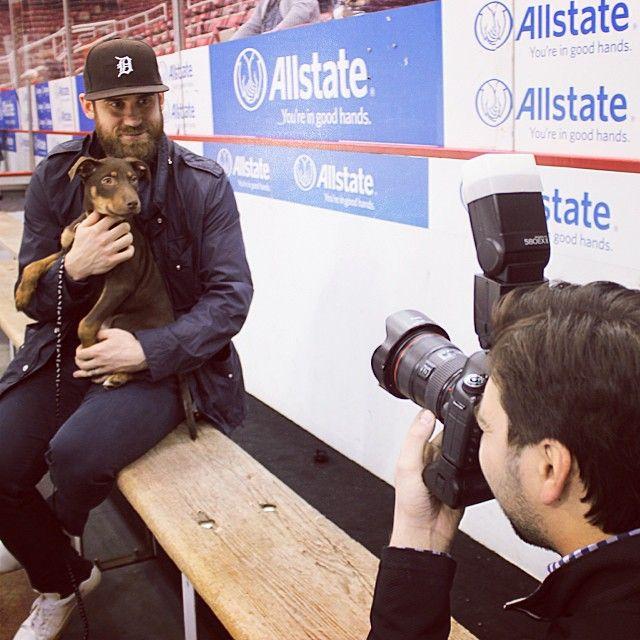 Behind the scenes look as captain Henrik Zetterberg poses with Maverick on the team bench during the @drwsocialmedia pet calendar photo shoot! #IMTH