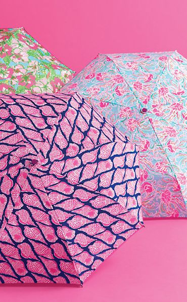 Lilly Pulitzer umbrellas are too cute! If I were to Use one on a rainy day I would just be happy. Ha ha ha