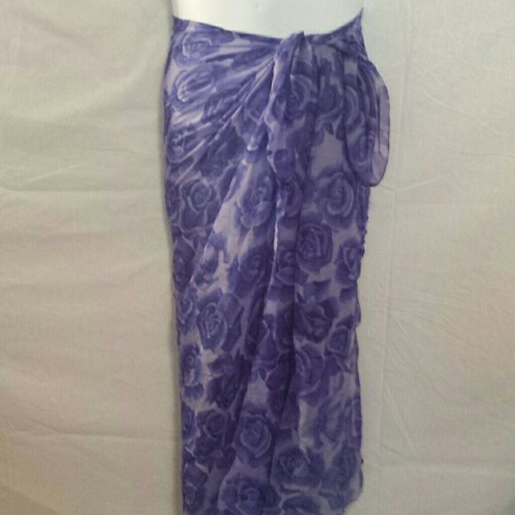Purple Roses Beach Bathing Suit Sarong Wrap This is a very pretty sarong wrap that has medium sized purple flowers all over it.  This wrap is longer so it could be tied at the hips or top! #sarong #wrap #beach #coverup Swim Coverups