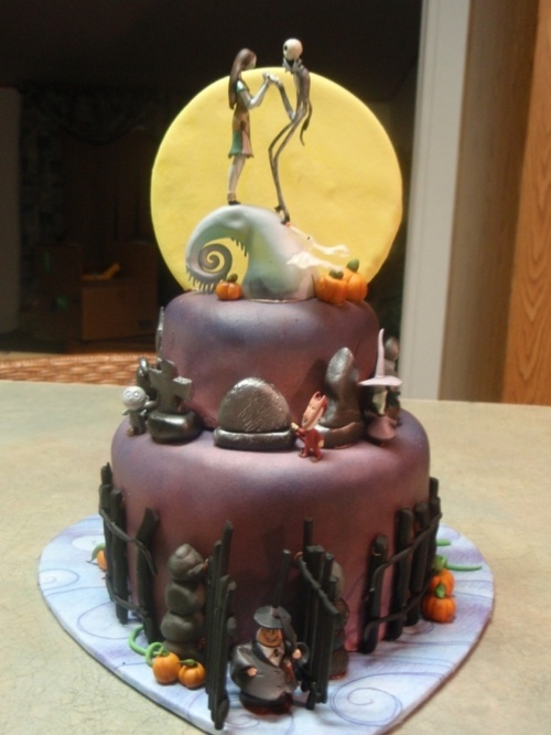 """Tim Burton's """"The Nightmare Before Christmas"""" Wedding Cake via Tumblr --- Better suited to a bridal party of dark purple. The other one from Cake Wrecks was much more Halloween black and orange color themed."""