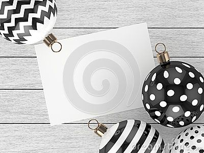 3d rendering of christmas, black and white baubles over wooden background with empty sheet