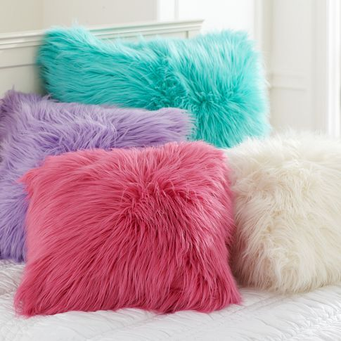 "Fake fur pillow covers from PB Teen - they look so soft, fluffy, and inviting to cuddle with! 26"" square, 38.99 dollars - or make your own!"