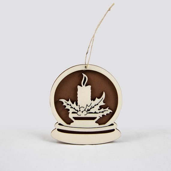Wooden snow globe Christmas ornament with a candle.