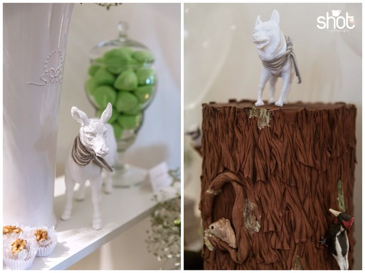 Minimalist forest scenery with animals all in white and gray striped scarf like the main character. Scenic cake donated by Vintage Cake Company.