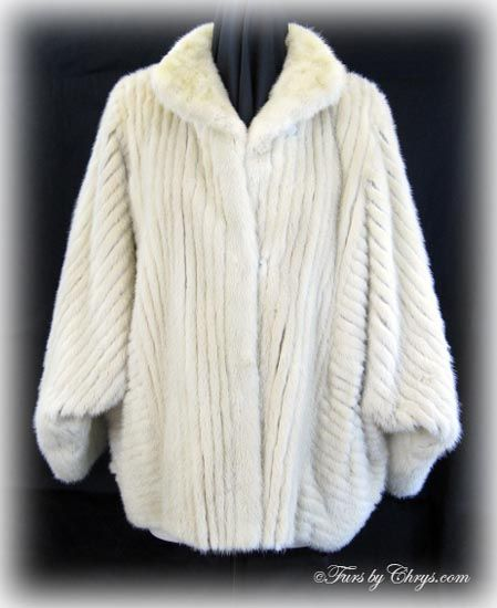 SOLD! Blush Mink Jacket #BM765; Very Good Condition; Size range: 12 - 16. This is a beautiful genuine dyed blush corded mink fur jacket in a very dramatic and elegant design. It has Saga Mink and J. Simon Furs labels and features a small shawl collar, dolman or batwing sleeves, and lightly padded shoulders.  This blush mink jacket exudes sophistication and style. It is able to be dressed or down and you will reach for it again and again when you want to turn heads!