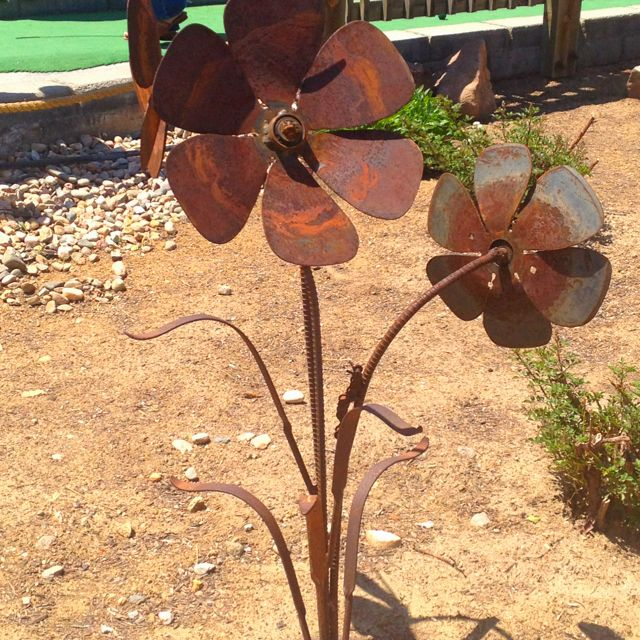 Metal flowers made from rebar & an old fan.