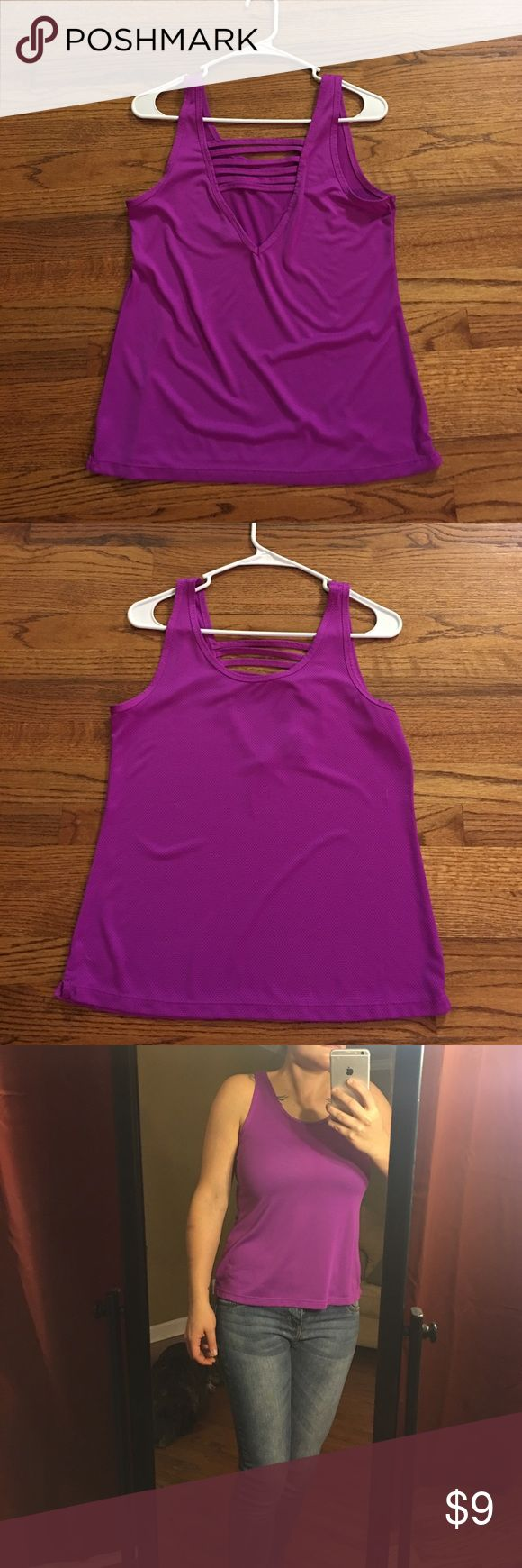 Strappy V-Back Athletic Tank Really pretty purple! When I've worn it, it's been for about an hour each and then it goes right in the wash. Super comfortable and has a little bit of stretch to it. If you want to see a picture of the back while it's worn I can have m husband take one when he's home. Rue 21 Tops Tank Tops