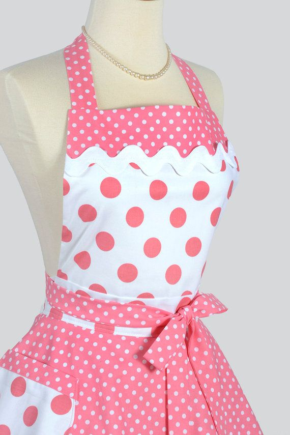 A full kitchen pin-up style apron in a flirty bubblegum pink large polka dot with smaller coordinating polka dots for the top skirt, trim and ties. Large white rick rack trims the bodice top. A lined pocket is perfect for having your phone handy. What makes a Creative Chic apron stand out from others: Highest Quality 100% Cotton Fabrics, fully lined bodice, waistband and pockets. Turned ties instead of bias tape. A super full skirt reflects the 1950s era. Apron can be washed in perm press…