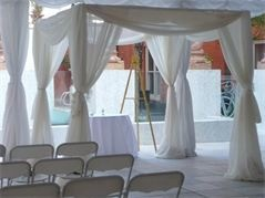 Use pop up awning frame and drape with crepe for free standing tents