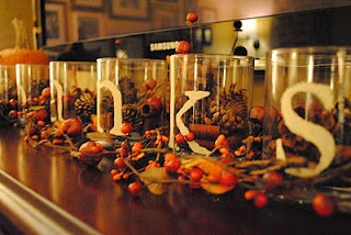 "A Time for Thanks- dollar store glass cups, stencil words ""thanks"" and fill with cinnamon potpourri/candy corn/acorns/pine cones. cheap and pretty thanksgiving decor!"