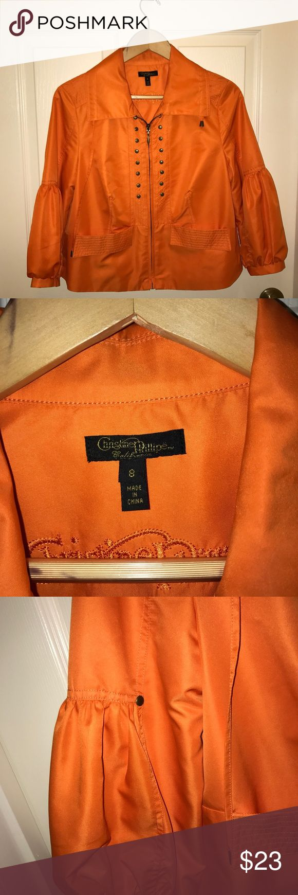 Orange zip up jacket Orange zip up jacket with metal studs and puffy sleeves. Also has a drawstring neckline. christine phillipe collection Jackets & Coats