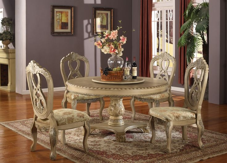 ... white wood round pedestal dining table set with intricate carvings