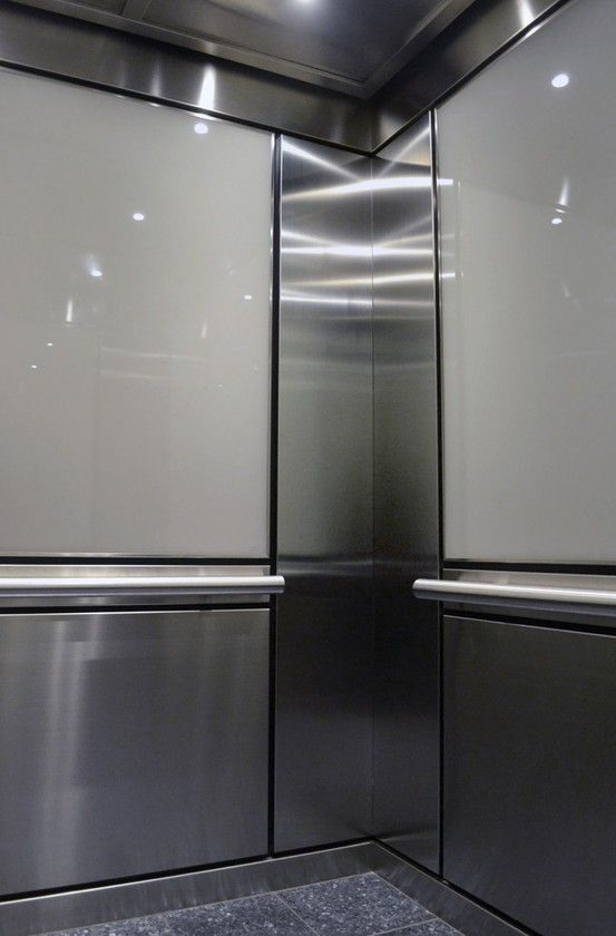 This durable elevator interior features brushed stainless for Elevator designs