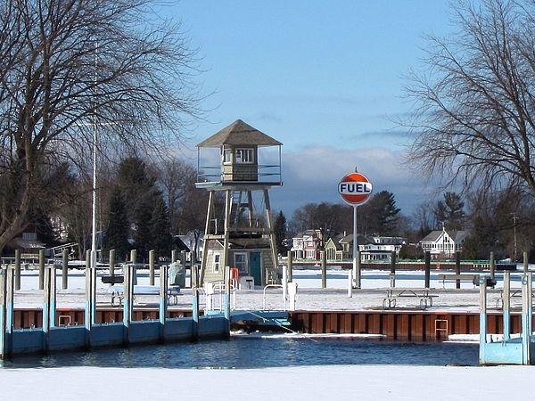 Snug in the Snow ~ Blue skies & fresh snow blanket Snug Harbor Marina in the Village of Pentwater Michigan USA