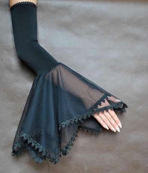 Lovely GOTHIC ELEGANT evening mistical gloves made of black high quality elastic fabric and tulle. Finished with guipure and rubber-lace with attention to details. Gloves are very effective! Perfect for special events. Handmade in Poland, not in China :) Gloves are made in one size and match best size medium. If You need another size, contact me (give me You measurements - girth of arm) and I will do special order for You. Find me on Facebook :) https://www.facebook.com/sophi...