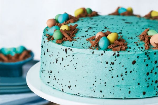 Speckled Easter Egg Chocolate Cake - Brilliant blue icing and a fun speckled effect make this show-stopping chocolate cake look like a robin's egg. It's the perfect Easter dessert.