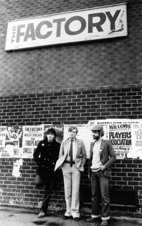 Peter Saville, Tony Wilson and Alan Erasmus outside the Russell Club in Hulme, April 1979 // Photo by Kevin Cummins //