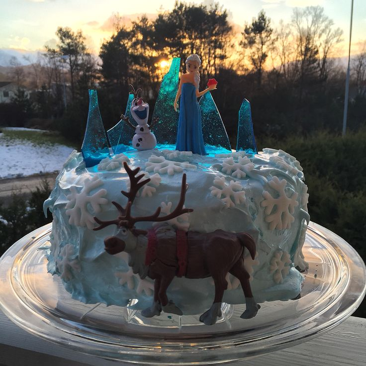 "Frozen birthday kake. White Vanilla Cake wit Angel Feather Icing, fondant snowflakes and candy ""ice""."